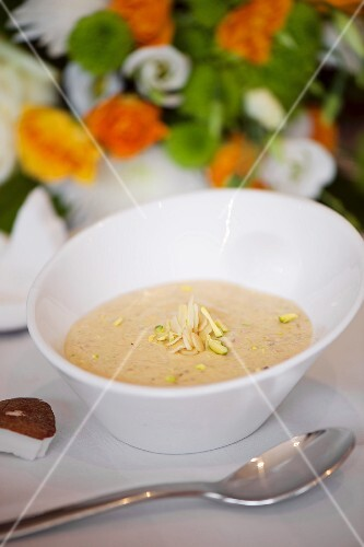 Indian soup with coconut, pistachios and almonds