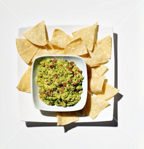 Bowl of Homemade Guacamole; Tortilla Chips