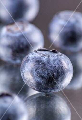 Blueberries on a mirror (close-up)