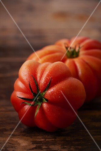 Two freshly washed beefsteak tomatoes