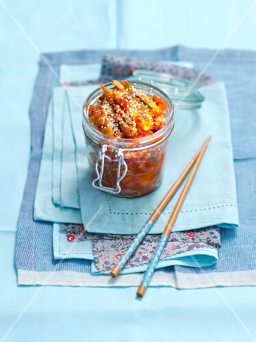 Kimchi with sesame seeds in a preserving jar (Korea)