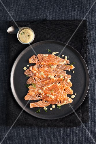Salmon carpaccio with a dill and mustard dressing