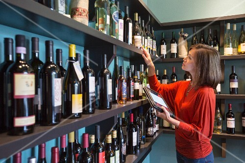 A woman working in a wine shop