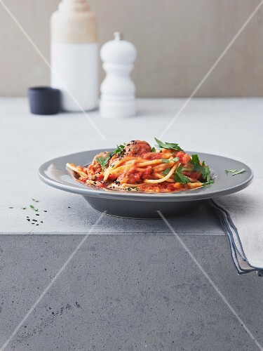 Spaghetti with meatballs in an oriental tomato sauce