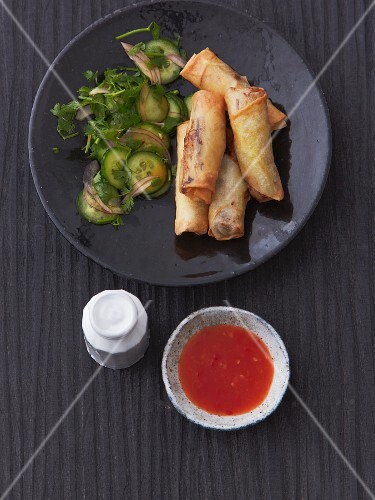 Spring rolls with cucumber salad and sweet and sour chilli sauce