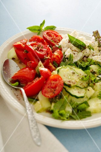 Mixed leaf salad with cucumbers, tomatoes, peppers, feta cheese and sumach