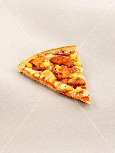 A slice of pizza with grilled chicken, sweetcorn and red onion