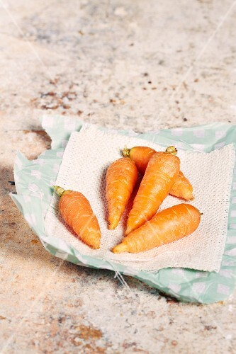 Baby carrots on a piece of paper