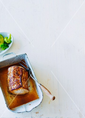 Juicy saddle of pork served with broccoli