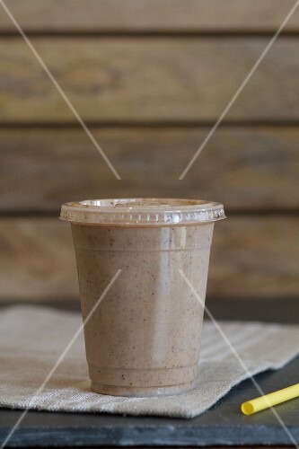 A smoothie made with almond milk, dates, bananas, cocoa, almond butter and cinnamon