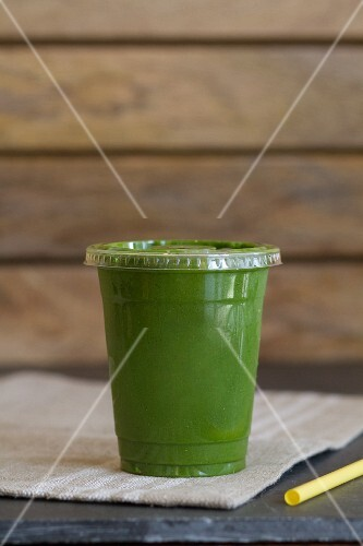 A smoothie made from blueberries, spirulina, kale and spinach, rice milk and bananas