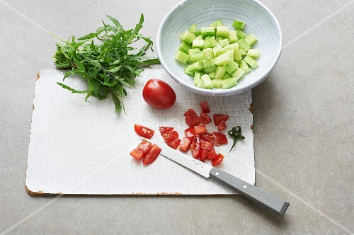 Diced tomatoes, cucumber and bunch of rocket