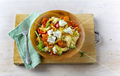 Fried couscous and vegetables with goat's cheese