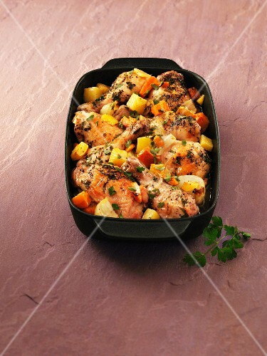 Chicken casserole with onions, pumpkin and parsley