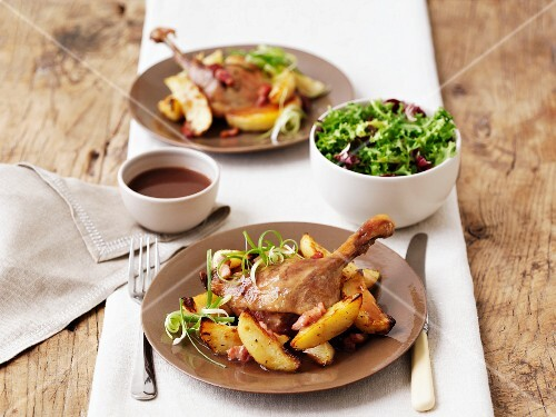 Duck confit with roast potatoes and salad