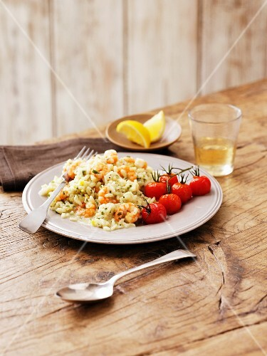 Seafood risotto with roast tomatoes