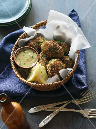 Crab cakes with a dip in a basket