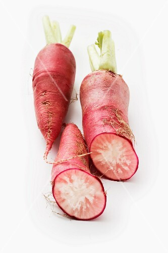 Red radishes on a white surface