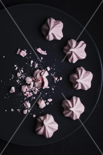 Pink meringues on a plate