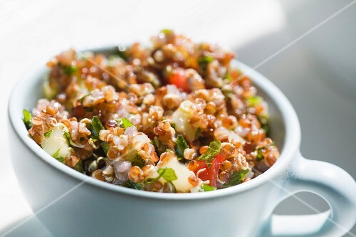 A cup of quinoa salad