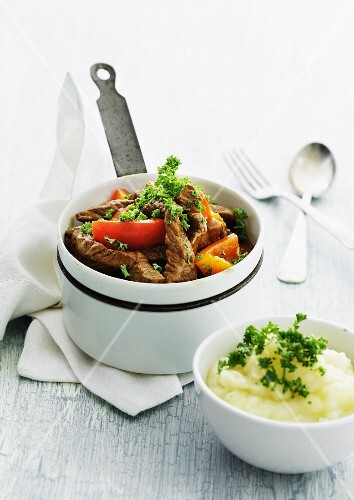 Beef stew with pepper served with mashed potatoes