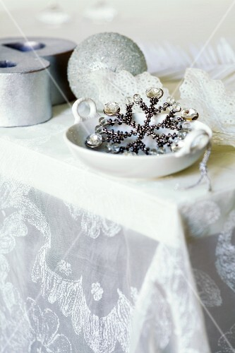 Glittering Christmas decorations on silk organza tablecloth by Carolyn Quartermaine