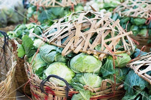 Baskets of cabbages at a market in China Town, Bangkok, Thailand