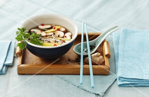 Soup with mushrooms, bean sprouts, ginger and chilli (Asia)