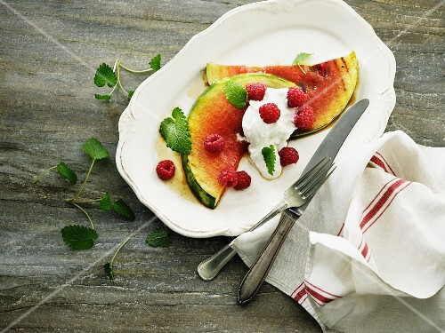 Grilled watermelon with cream cheese and raspberries