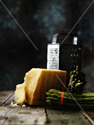 Parmigiano with green asparagus and a grater