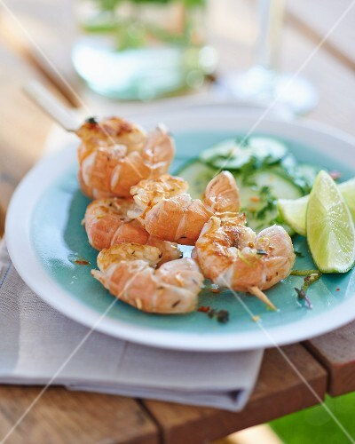 Grilled prawn skewers with a cucumber salad
