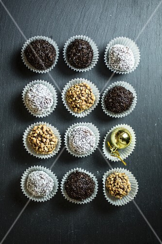 Rum balls with coconut, chocolate sprinkles and nuts (Christmas)