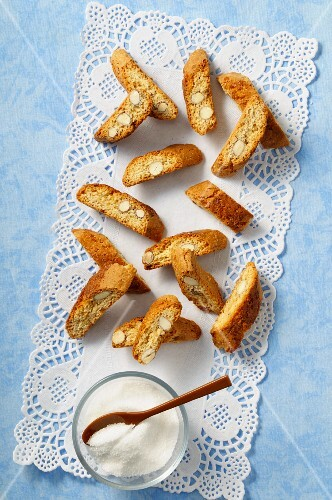 Biscotti on a doily with a sugar bowl