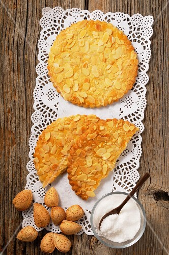 Sables with flaked almonds on a doily