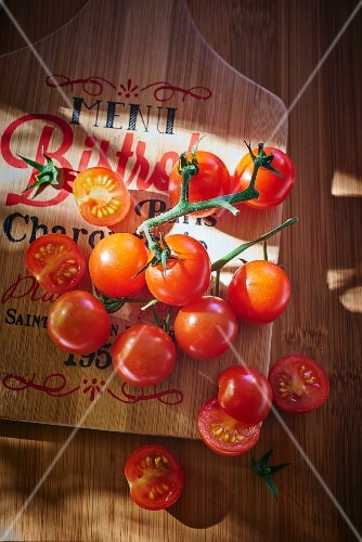 Cherry tomatoes on chopping board