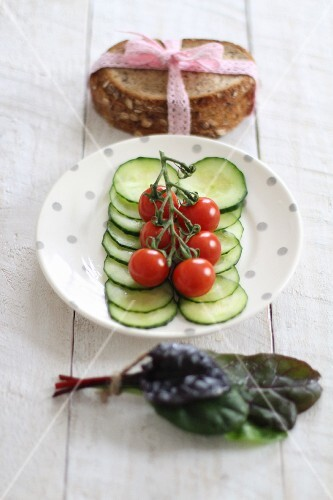 A plate of salad with bread