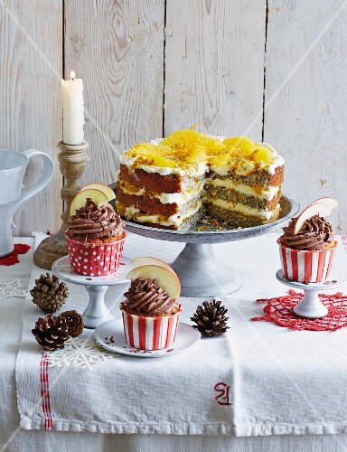 Baked apple cupcakes and orange and poppyseed cake, sliced (Christmas)