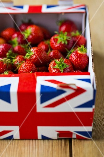 Fresh British strawberries in a box on a wooden table