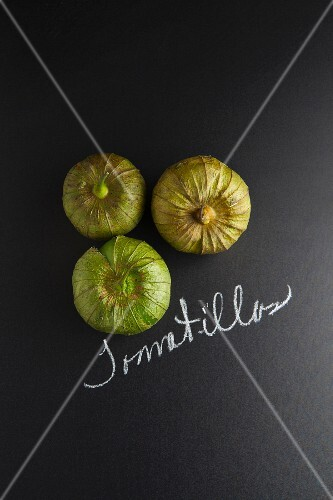 Three tomatillos with a label