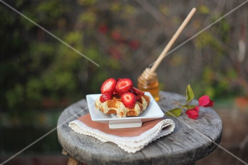 Waffles with strawberries and honey
