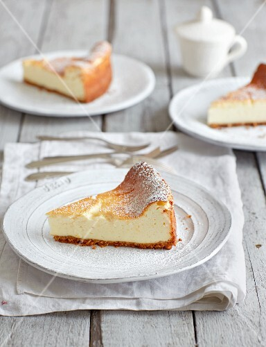 Three slices of cheesecake on plates