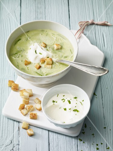 Foamy wild garlic soup with parsley cream and croutons