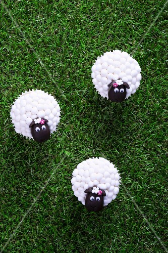 Easter lamb cupcakes on a grass surface