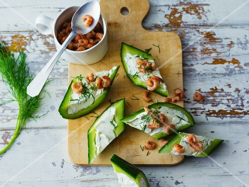 Cucumber canapés filled with cream cheese and North Sea shrimps