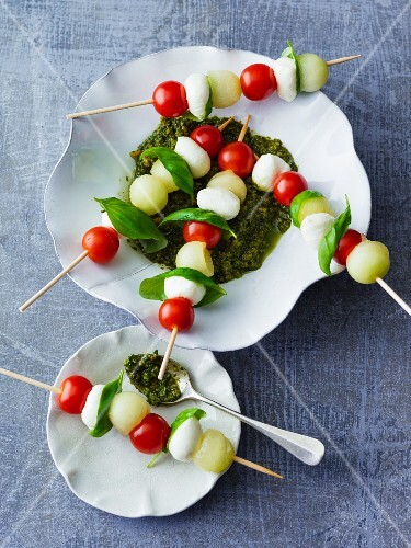 Mozzarella skewers with galia melon and cherry tomatoes