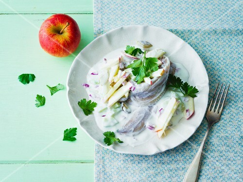 Soused herring in yoghurt cream with cucumber, apple and onion