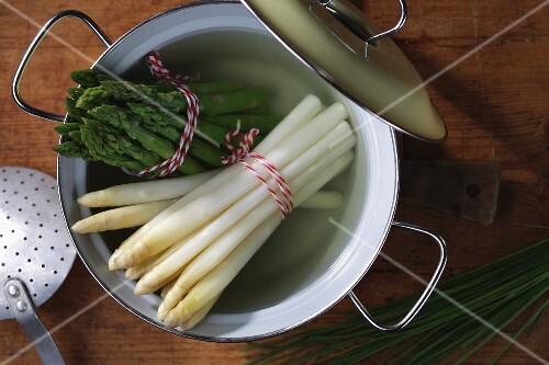 Boiled white and green asparagus in a pot