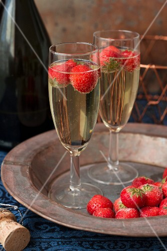 Two glasses of champagne with fresh strawberries