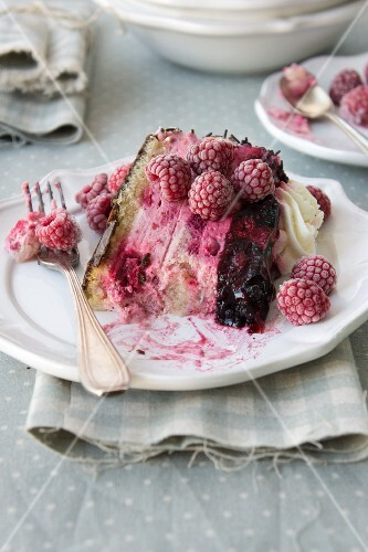 A slice of raspberry and blackberry cake