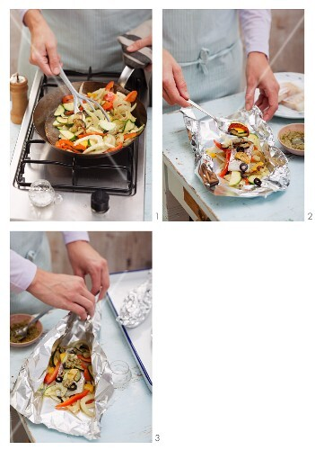 Steamed fish fillet with Mediterranean vegetables in aluminium foil being prepared
